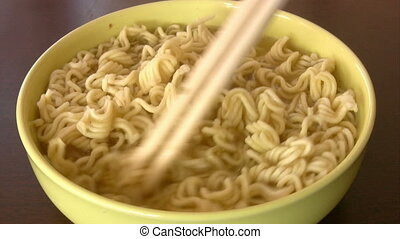 Mixes noodles