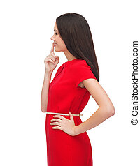 young woman in red dress choosing