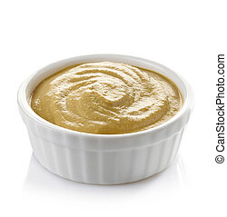Bowl of mustard on white background