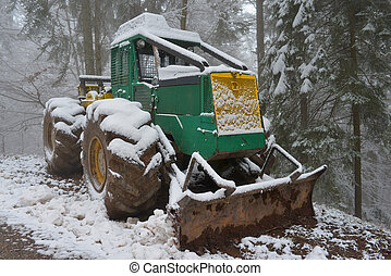 skidder in the snow on the roadside