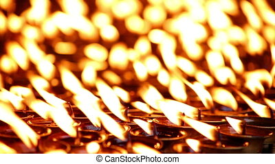Candles burning at Boudhanath, Kathmandu, Nepal - Candles...