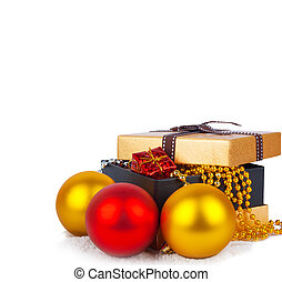Golden gift box with Christmas balls and garlands of...