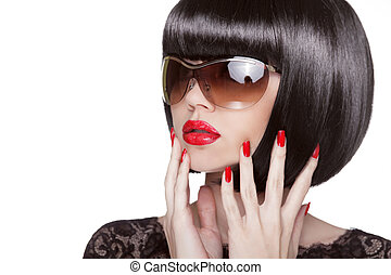 Fashion portrait of brunette woman in sunglasses showing red manicured polish nails. Professional makeup and hairstyle. Model isolated on white background.