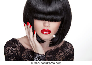 Beautiful brunette woman with hairstyle and red lips, manicured nails posing isolated on white background