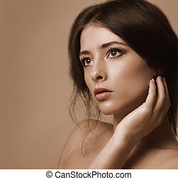 Closeup portrait of beautiful woman looking lonely on color...
