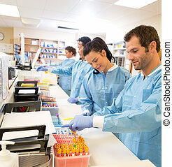 Researchers Experimenting In Laboratory - Hospital lab...