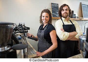 Confident Workers At Counter In Coffee shop - Portrait of...