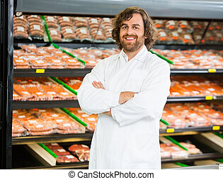 Salesman, Standing, Arms, Crossed, In, Butcher's, Shop