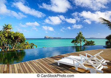Tropical relax in Mauritius - Swimming pool with deckchairs...
