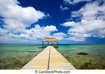 Boat jetty - Calm scene with jetty and turquoise water in...