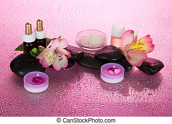 Set of fragrant oils, salt, candles, stones, a flowe, on a...