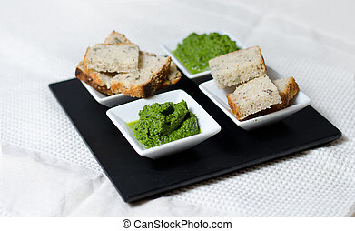 Green sauce and bread slices - Green sauce and slices of...