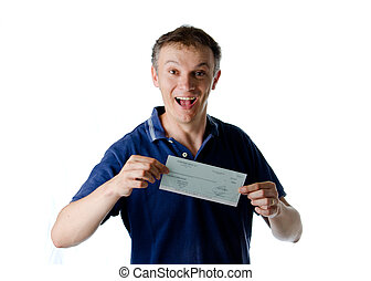 Handsome man holding check or cheque and smiling, looking at...