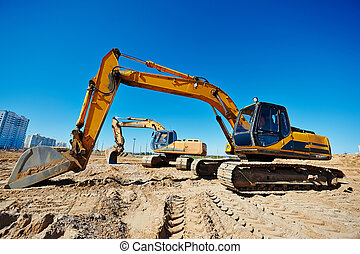 track-type loader excavators at work - Two track-type loader...
