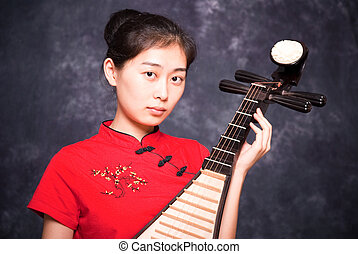Chinese lutanist - Chinese lute player in red shirt on...