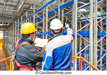 warehouse worker in storehouse - two warehouse worker in...