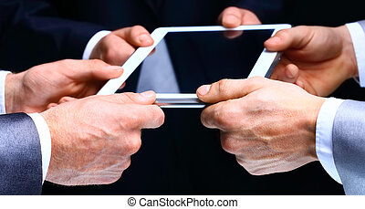 Businessman hands with tablet computer. Technology.