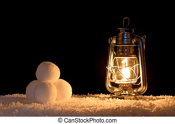 Snowballs and lantern - Snowballs illuminated by the light...