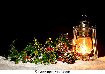 Lantern with holly and ivy - An oil filled lantern sitting...