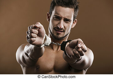 Arrested man - Handsome young man arrested with handcufs on...