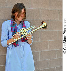 Female trumpet player. - Female trumpet player posing with...
