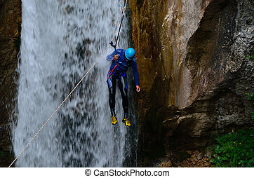 rappelling in a waterfall with a mountain tour