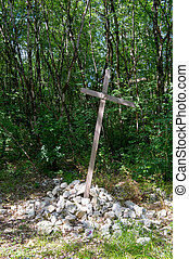 Simple cross with white stones in nature