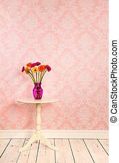 Vintage wall and wooden floor with vase flowers on table -...