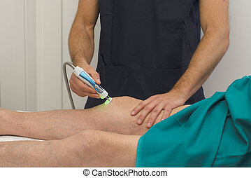 Physiotherapy and rehabilitation - Laser therapy on a knee
