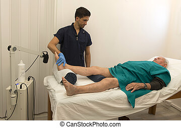 Physiotherapy and rehabilitation - ultrasound therapy on an...