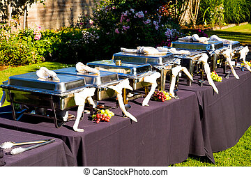 Wedding Banquet Feast Setup - A wedding buffet is setup and...