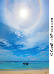 Clouds over Koh Lipe - Halo around the sun over boats in the...