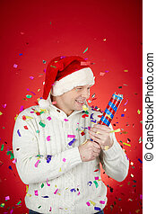 Merriment - Portrait of joyful man in Santa cap and white...