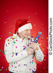 Merriment - Portrait of joyful man in Santa cap and white...