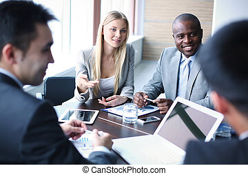 Negotiation - Image of business people listening and talking...