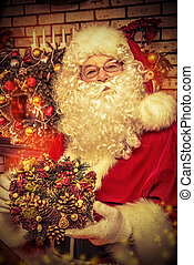 Christmas wreath - Santa Claus making Christmas gifts at...