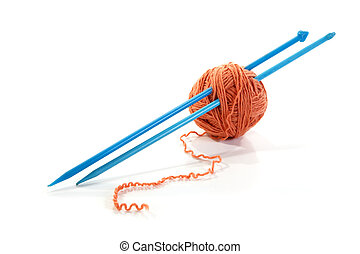 Balls of a yarn knitting spokes on white background