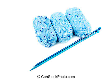 blue balls of a yarn knitting spokes isolated on white