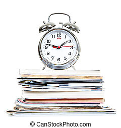 Alarm-clock and documents on a white background