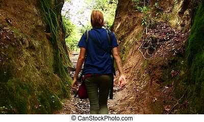 Female caucasian tourist trekking walking at himalayan...
