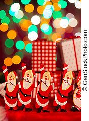 toy santa claus with christmas gifts on the background