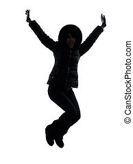woman winter coat jumping happy silhouette - one woman in...