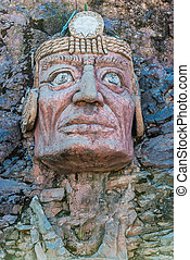 Inca face sculpture in the peruvian Andes at Puno Peru