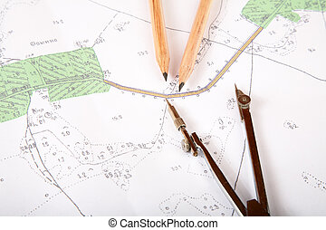 Topographic map of district with a measuring instrument and...