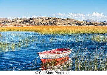 boat in Titicaca Lake peruvian Andes at Puno Peru - boat in...
