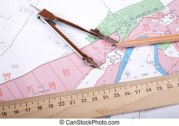 Topographic map of district with measuring instrument, ruler...