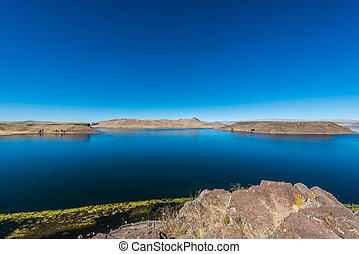 Titicaca Lake from Silustani in the peruvian Andes at Puno...
