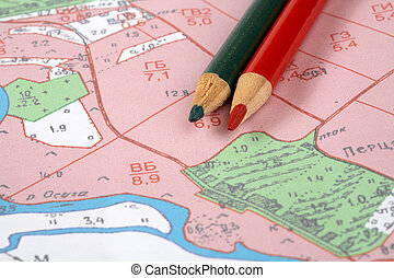 Topographic map and pencils - Topographic map and colour...