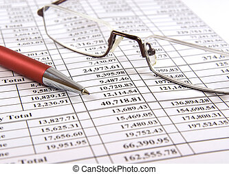 Pen and glasses on financial report - Close-up pen and...