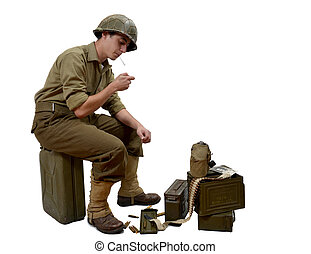young American soldier light a cigarette - young American...